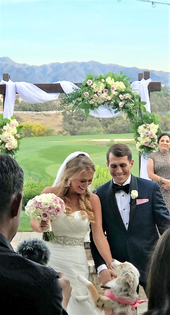 Oaks Grill Wedding Ceremony in Valencia California, bridal bouquet, Wedding Arch with Fabric Draping