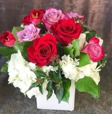 Mix of roses in small square vase